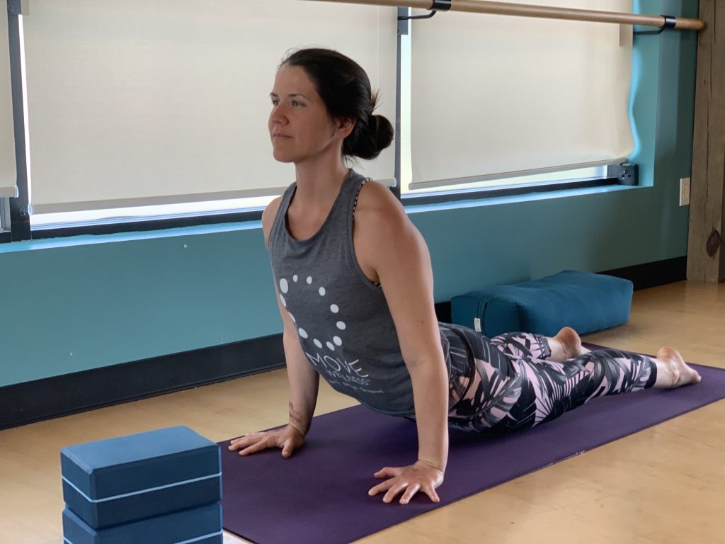 Yoga Teacher showing us how to be heart healthy by managing stress