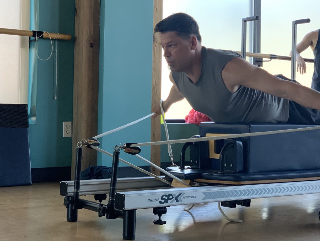 MOVE Instructor Trainee Kenny on the Reformer