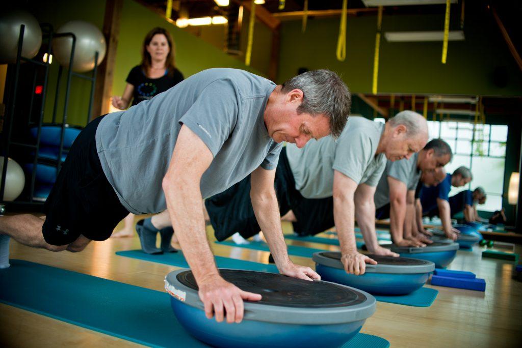 A Men's Pilates class on the Bosu.