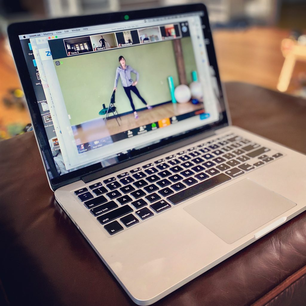 Livestream Fitness Class shown on a laptop screen