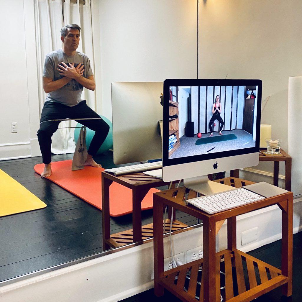 Man doing online Pilates class