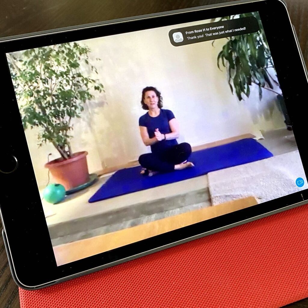 Pilates Instructor on Mat seen on iPad screen