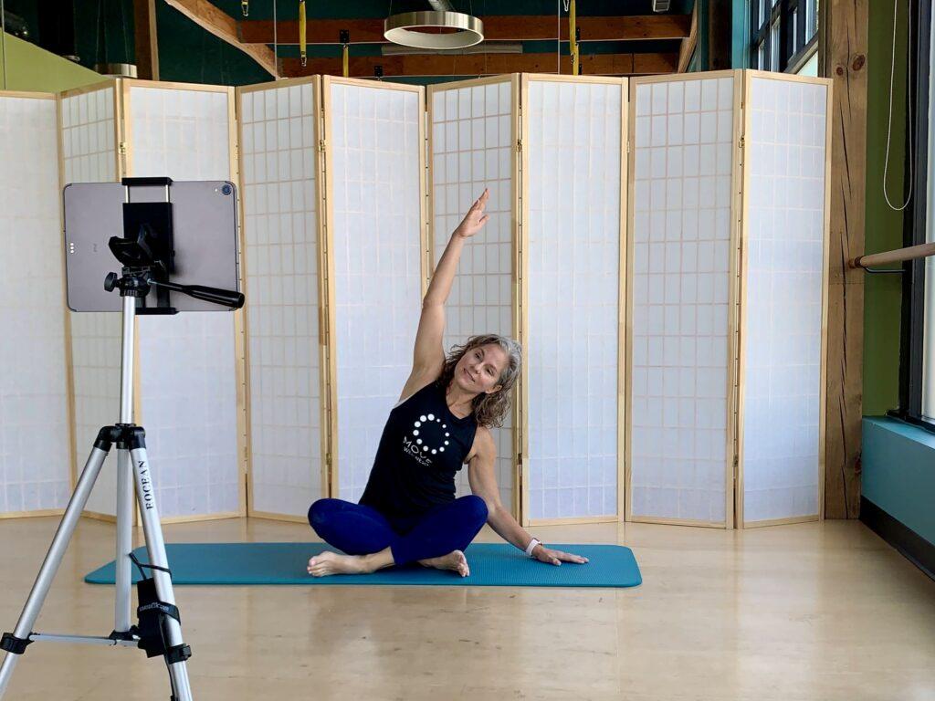 Elaine Economou teaching an online Pilates class