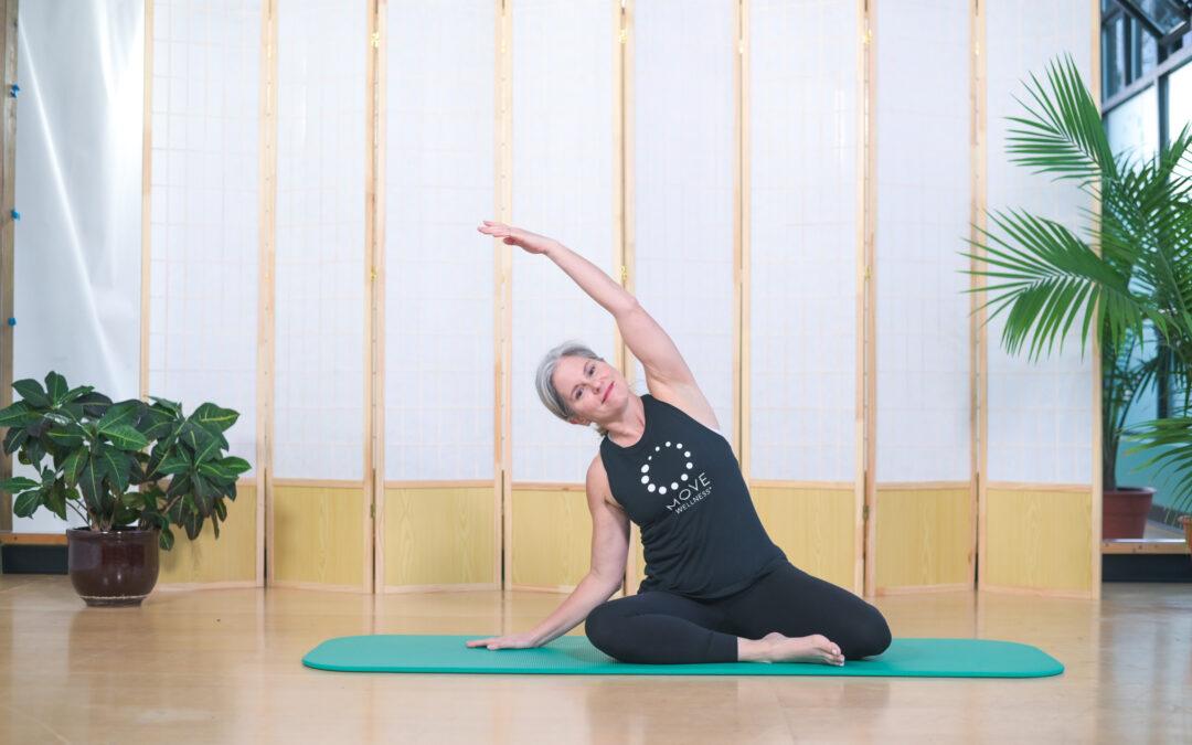 Elaine Economou doing a Pilates mermaid stretch to alleviate back pain